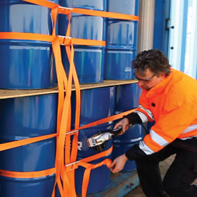 Lashing of a container filled with drums with CornerLash tensioned using a pneumatic tensioner.